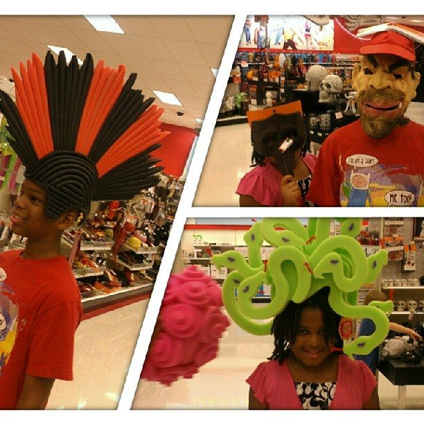 Q and Kaleya playing around with Halloween costumes in Target